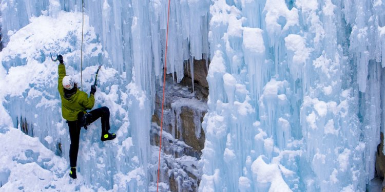 A climber scales the icy walls