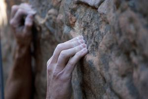 A climbers finger tips grasp a hold - Brent Winebrenner/Lonely Planet Images/Getty Images