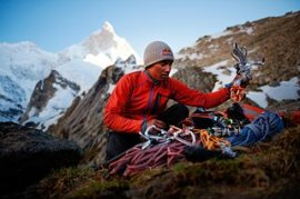 David Lama preparing his equipment to climb the Masherbrum in Pakistan.