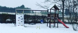 Kids climbing frame in the snow