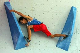 Rock Climber on indoor wall, climbing shoes